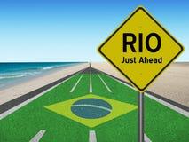Route vers le Brésil avec des mots Rio juste en avant Photographie stock libre de droits