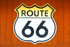 Route 66 wooden background. Historic Route 66 road sign on a wood wall in Barstow, California, famous crossroads between Los Angeles and Las Vegas. Mother Road royalty free stock photos