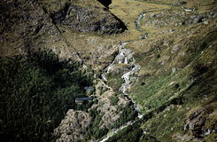 Routeburn Falls and Lodge. Scenic Routeburn Falls and Lodge in Mount Aspiring National Park, New Zealand.  Taken at a distance Stock Photo