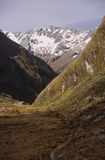 Routeburn Track. Two hikers show the scale of the majestic mountains encountered along the Routeburn Track on New Zealand's South Island Stock Image