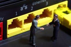 Router B de los hombres de negocios Imagen de archivo libre de regalías