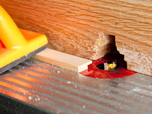 Router blade cutting rebate in strip of wood Stock Images