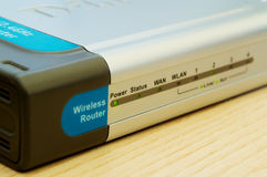 Router on a desk. A close-up shot of a powered-on wireless router on a desk Stock Photos