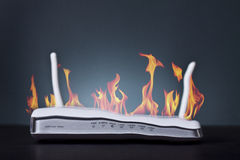 Router on fire Stock Photography