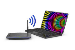 Router and  laptop Royalty Free Stock Images