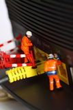 Router miniature model workers B Royalty Free Stock Images
