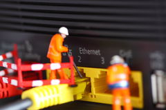 Router miniature model workers C Royalty Free Stock Image