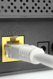 Router. Network cable connected to a router. Close-up Stock Photography