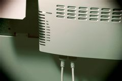 A router in working mode placed on a wall stock photos