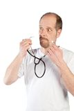Routine health check. A doctor is using his stethoscope to do a health check Stock Photography