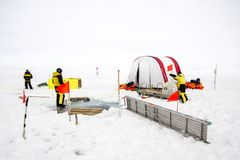 ROV camp of a polar research expedition. Weddell Sea, Antarctica – September 19, 2013: Scientists from a research icebreaker are establishing a remotely stock photography