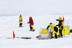 ROV camp of a polar research expedition. Weddell Sea, Antarctica – September 19, 2013: Scientists from a research icebreaker are establishing a remotely royalty free stock photography