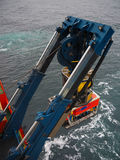 ROV or remote operated vehicle deployed off the side of a ship Stock Images