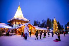 Rovaniemi - December 31, 2015: Tourists enjoying the winter in S stock photo