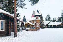 Santa Village Lapland Finland. Rovaniemi, Finland - March 5, 2017: Santa Claus Office in Santa Village, Lapland, in Finland, on Arctic Circle in winter. People royalty free stock image
