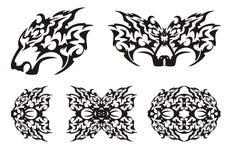 Rovdjurs- huvud och beståndsdelar i stam- stil Arkivfoton