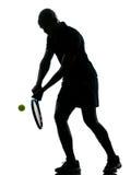 Rovescio del giocatore di tennis dell'uomo Immagine Stock