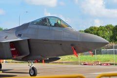 Rovfågel för U.S.A.F. Lockheed Martin F22 på skärm på Singapore Airshow Royaltyfria Foton