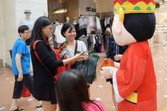 Roving God of Fortune mascot at Jurong Point 2018 Singapore stock image