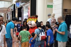 Roving God of Fortune mascot at Jurong Point 2018 Singapore royalty free stock photo