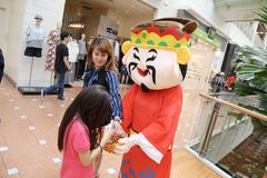Roving God of Fortune mascot at Jurong Point 2018 Singapore stock photo