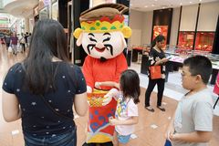 Roving God of Fortune mascot at Jurong Point 2018 Singapore royalty free stock images