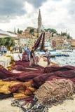 ROVINIJ, CROATIA, SEPTEMBER 27, 2017: Fisher in on the dock are stock photography