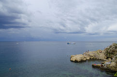 Rovinj beach. Beach along the coast of Adriatic sea. Photo is taken in Rovinj in Croatia. Beach is made from dtone Royalty Free Stock Image