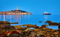 Free Rovinj, Croatia. Antique Medieval Old Town Nighttime View. Luxury Yacht And Fishing Sea. Big Stones Royalty Free Stock Images - 155443459