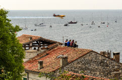 ROVINJ, CROATIA - APRIL 13 2014 spectators on roof at Red Bull A Royalty Free Stock Photography
