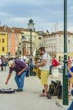 ROVINJ, CROATIA, SEPTEMBER 27, 2017: Street artist playing music royalty free stock photos
