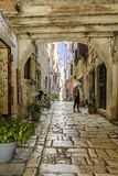 ROVINJ, CROATIA, SEPTEMBER 27, 2017: unknown person walking on a old cobbled street in Rovinj. Stock Photography