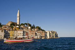 Rovinj in the morning. Rovinj houses in the early morning standing just out of the sea Stock Image
