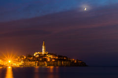 Rovinj old town at night with moon on the colorful sky, Adriatic sea coast of Croatia, Europe