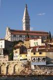 Rovinj, St. Euphemia's Basilica. Ancient mediterranian city Rovinj and St. Euphemia's Basilica viewed from the sea Stock Photography