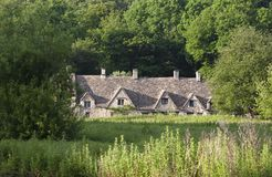 Row of 14th Century English Cotswold cottages Stock Photos