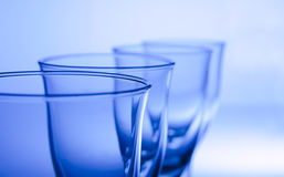 Row. 4 glasses in a row in a abstract top view stock photos