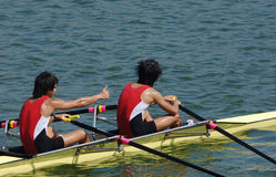 Row. Two athlets in a rowing competition Stock Photos