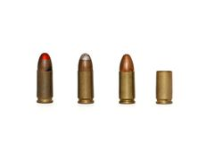 Row of 9mm cartridges and spent case isolated Royalty Free Stock Photo