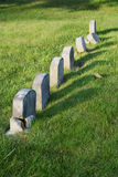 Row of aged tombstones Royalty Free Stock Images