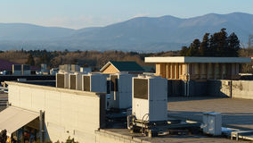 A row of air conditioning units on a rooftop. Stock Photo