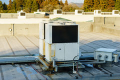 A row of air conditioning units on a rooftop. Stock Photography