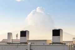 A row of air conditioning units on a rooftop. Stock Images