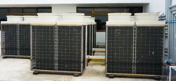 Row of air conditioning units on rooftop Stock Photo