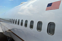 A row of airplane windows stock photography