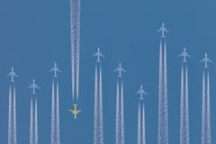 Row of airplanes flying by stock photography