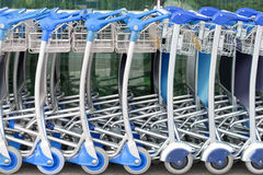 Row of airport luggage trolleys Stock Photography