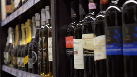 Row of alcoholic drinks in the store stock video footage