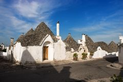 A row of amazing trulli houses in Alberobello, Puglia, Italy. A fine white housed street in Alberobello, Italy, with trulli Royalty Free Stock Photo