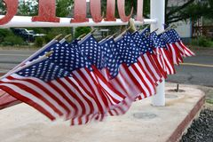 American flags. Row of american flags waving in the wind royalty free stock images